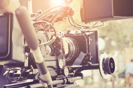 Foto de Cameraman with his video camera shooting, Hands Adjusting Camera,film production crew, behind the scenes background. - Imagen libre de derechos