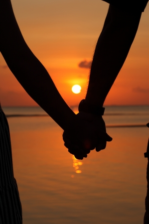 Photo for Silhouettes couples holding hands. - Royalty Free Image