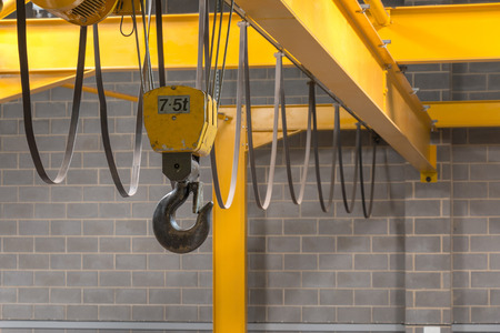 Foto de Yellow Indoor Crane's Hook and Black Sling - Imagen libre de derechos