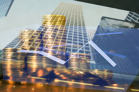 Photo pour Double exposure Stack of coin with financial graph over city and office building background, business and financial concept idea. - image libre de droit