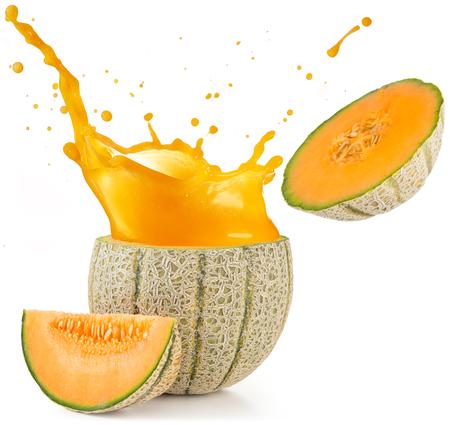 Foto de orange juice splashing out of a melon isolated on white - Imagen libre de derechos