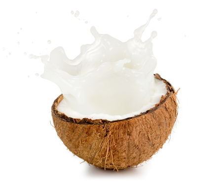 Photo for coconut milk spilling out of an half fruit - Royalty Free Image