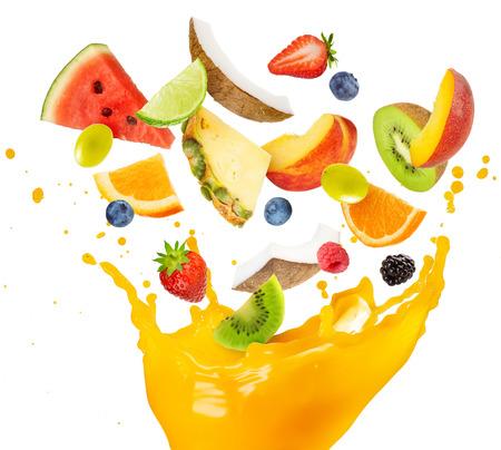 Foto de fruit salad falling into splashing orange juice - Imagen libre de derechos