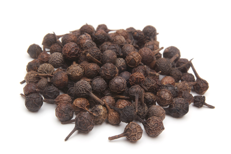 Photo pour Cubeb pepper Piper cubeba on white background - image libre de droit