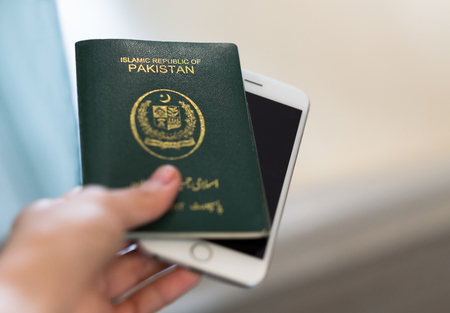 Photo for A hand holds Pakistan passport. Focus on the font on passport. - Royalty Free Image