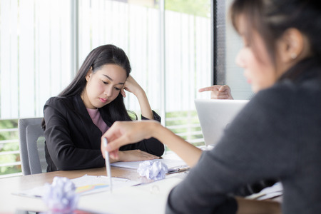 Foto de Asian woman working with serious situation at office, woman with stressful concept,  20-30 years old. - Imagen libre de derechos