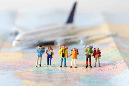 Foto de Miniature model team traveller model standing together on map, people travel in concept, - Imagen libre de derechos