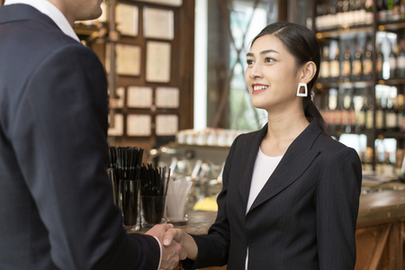Woman with Agreement for Working with Businessman at Bar. Business handshake and business people concet. Business team handshake concept.
