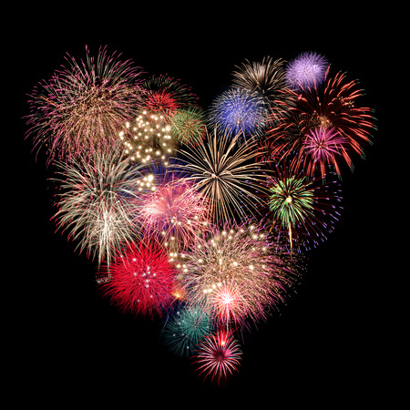 Photo pour Heart Fireworks Celebration on black Background - image libre de droit