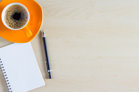 Photo pour Office table with notepad and coffee cup. View from above with copy space - image libre de droit
