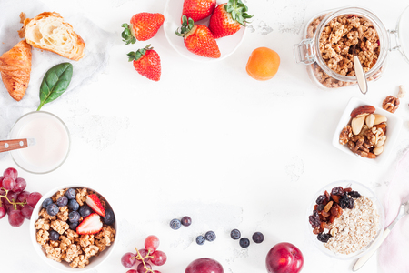 Photo pour Healthy breakfast with muesli, fruits, berries, nuts on white background. Flat lay, top view - image libre de droit