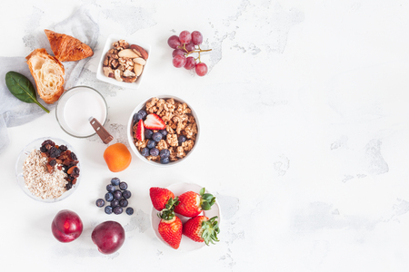 Photo for Healthy breakfast with muesli, yogurt, fruits, berries, nuts on white background. Flat lay, top view - Royalty Free Image