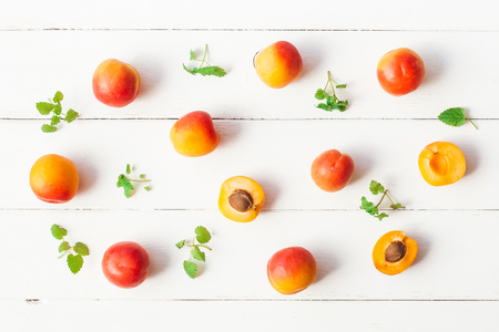 Photo for Apricot on white wooden background. Sliced apricot top view, flat lay - Royalty Free Image