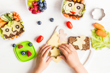Photo for School lunch box for kids. Cooking. Child's hands. Backto school. Top view, flat lay - Royalty Free Image