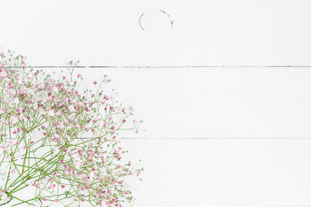 Photo pour Flowers composition. Floral frame made of pink gypsophila flowers on white wooden background. Flat lay, top view, copy space - image libre de droit
