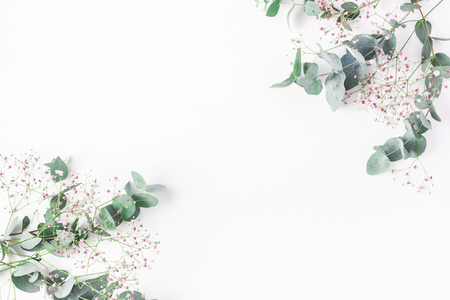 Photo pour Flowers composition. Frame made of of pink gypsophila flowers and eucalyptus branches on white background. Flat lay, top view, copy space - image libre de droit