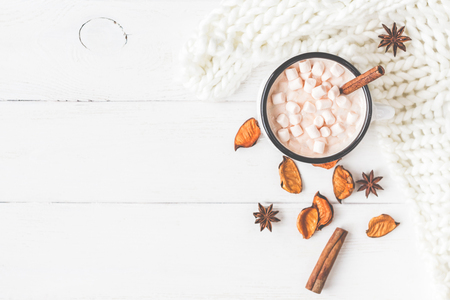 Photo pour Autumn composition. Hot chocolate, knitted blanket, autumn leaves. Flat lay, top view, close up - image libre de droit
