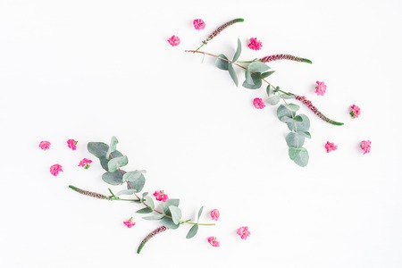 Photo pour Flowers composition. Frame made of pink flowers and eucalyptus branches on white background. Flat lay, top view, copy space - image libre de droit