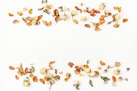 Foto de Autumn composition. Border made of autumn dried flowers and leaves on white background. Flat lay, top view, copy space. - Imagen libre de derechos