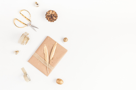Photo pour Christmas composition. Christmas gift, pine cone, golden accessories on white background. Flat lay, top view, copy space - image libre de droit
