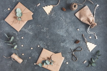 Photo for Christmas composition. Christmas gifts and eucalyptus branches on black background. Flat lay, top view, copy space - Royalty Free Image