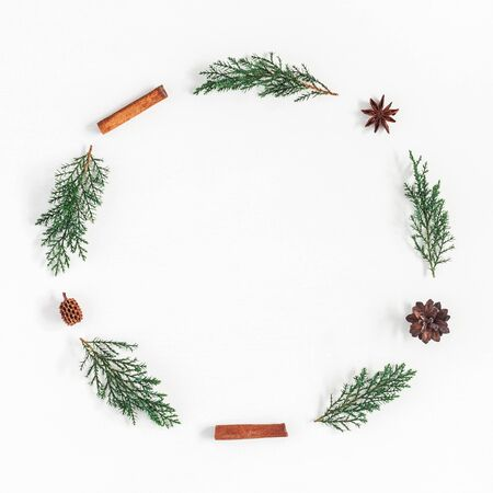 Photo pour Christmas composition. Christmas wreath made of pine branches, cinnamon stick, anise stars on white background. Flat lay, top view, copy space, square - image libre de droit
