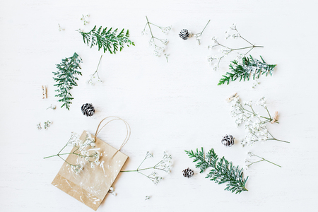 Photo pour Christmas composition. Christmas gift, pine cones, thuja branches and gypsophila flowers. Top view, flat lay - image libre de droit