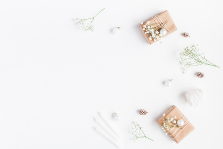 Photo pour Christmas composition. Frame made of christmas gifts, pine cones, gypsophila flowers on white background. Flat lay, top view, copy space - image libre de droit
