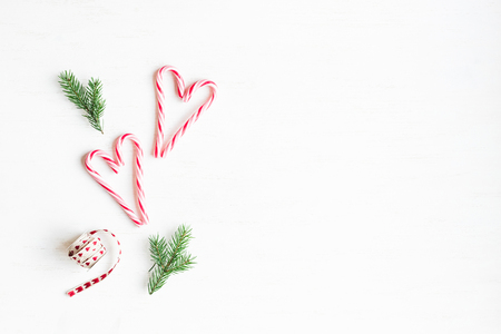 Photo for Christmas composition. Christmas candy canes and fir branches. Flat lay, top view - Royalty Free Image