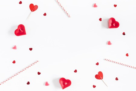Foto de Valentine's Day. Frame made of candles, confetti on white background. Valentines day background. Flat lay, top view, copy space - Imagen libre de derechos