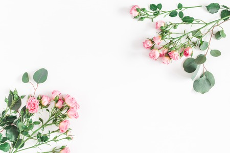 Photo pour Flowers composition. Frame made of rose flowers and eucalyptus branches on white background. Flat lay, top view, copy space - image libre de droit