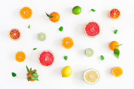 Photo pour Fruit background. Colorful fresh fruits on white table. Orange, tangerine, lime, lemon, grapefruit. Flat lay, top view - image libre de droit