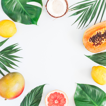 Photo for Summer tropical composition. Green palm leaves and tropical fruits on gray background. Summer concept. Flat lay, top view, copy space - Royalty Free Image