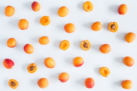 Photo pour Apricots on pastel blue background. Flat lay, top view - image libre de droit