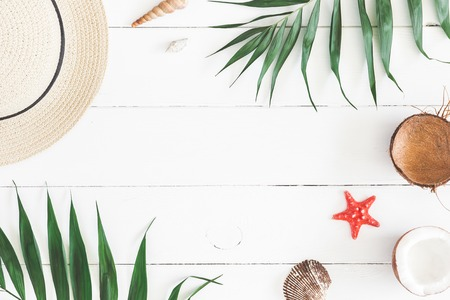 Photo for Summer composition. Tropical palm leaves, hat, pineapple, coconut on white wooden background. Summer concept. Flat lay, top view, copy space - Royalty Free Image