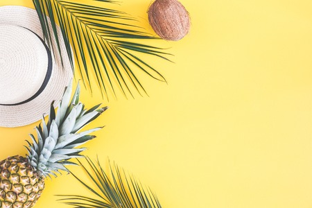 Photo for Summer composition. Tropical palm leaves, hat, pineapple, coconut on yellow background. Summer concept. Flat lay, top view, copy space - Royalty Free Image