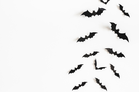 Photo pour Halloween paper decorations on white background. Halloween concept. Flat lay, top view, copy space - image libre de droit