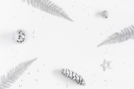 Foto de Christmas composition. Christmas ball, silver decorations on white background. Flat lay, top view, copy space - Imagen libre de derechos