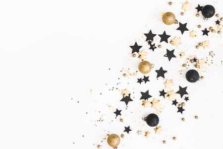 Photo pour Christmas composition. Christmas golden and black decorations on white background. Flat lay, top view, copy space - image libre de droit