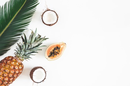 Photo for Summer composition. Tropical palm leaves, fruits on white background. Summer concept. Flat lay, top view, copy space - Royalty Free Image
