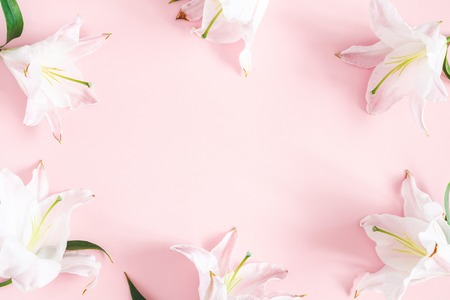 Photo pour Flowers composition. Lily flowers on pastel pink background. Flat lay, top view, copy space - image libre de droit