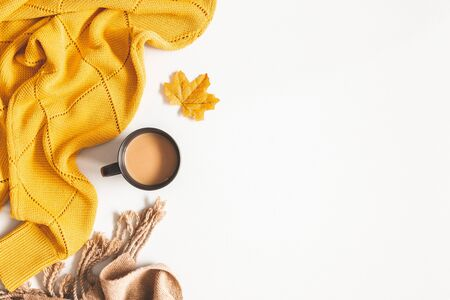 Photo pour Autumn composition. Cup of coffee, yellow sweater, plaid on white background. Autumn, fall concept. Flat lay, top view, copy space - image libre de droit