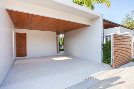 Photo for Interior and exterior design of white carport with wooden ceiling and wooden gated area - Royalty Free Image