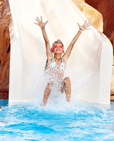 Photo for Child on water slide at aquapark. Summer holiday. - Royalty Free Image