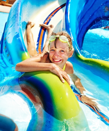 Photo for Child on water slide at aquapark  Summer holiday  - Royalty Free Image