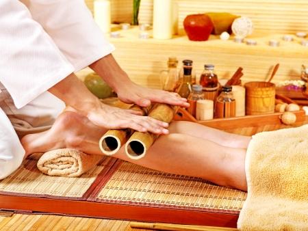 Woman getting feet massage Male therapist.