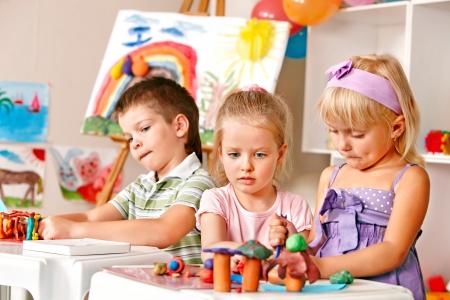 Foto de Group of children  in preschool thumb up. - Imagen libre de derechos