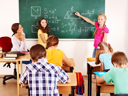 Photo for School child with teacher in classroom. - Royalty Free Image