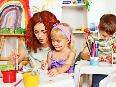 Foto de Child with mother painting . Child care. - Imagen libre de derechos