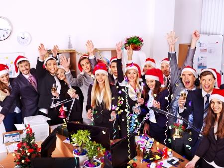 Photo pour Happy business group people in santa hat at Xmas party. - image libre de droit